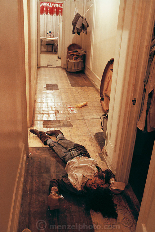 (1992) A Crime Scene Unit responds to the dispatcher's call of a body found in a closet in the Bronx. The suspect confessed at the 44th precinct while detectives were gathering evidence at the crime scene. He had smoked ten vials of crack cocaine and killed his girlfriend in his father's apartment bedroom, then mopped up the blood, but left pieces of the mop on the floor and bloody sheets in a bucket in the bathtub. The detectives took samples of the mop, bed sheets and blood on the floor. They bagged the hands of the victim for analysis at the morgue. Bronx, NYC. DNA Fingerprinting..