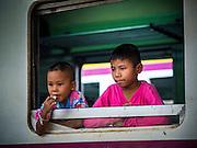 22 OCTOBER 2014 - BANGKOK, THAILAND: Children on a train wait for the train to leave Hua Lamphong Train station in Bangkok.      PHOTO BY JACK KURTZ
