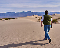 Michael Walking into Mesquite Flats Sand Dunes. Death Valley National Park. Image taken with a Leica X1 camera (ISO 100, 24 mm, f/5.6 1/500 sec).