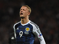 Football - 2016 / 2017 World Cup Qualifier - UEFA Group F: Scotland vs. Slovenia<br /> <br /> Leigh Griffiths of Scotland in pain after a knee in the back from Jan Oblak of Slovenia during the match at Hampden Park.<br /> <br /> COLORSPORT