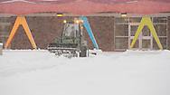 Photo Randy Vanderveen<br /> Grande Prairie, Alberta, Canada<br /> 2017-01-05<br /> A small tractor with a rear mounted blade clears snow from the east entrance to the Grande Prairie Composite High School. Custodians and maintenance staff will be kept busy with the snow-clearing task getting walkways cleared for the return of students from Christmas break Monday.