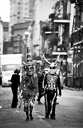 17 Feb 2015. New Orleans, Louisiana.<br /> Mardi Gras Day. Walking with Skeletons. <br /> Stopping for portraits in the French Quarter. The Skeleton Krewe meets before dawn beside a cemetery in Uptown New Orleans. They then walk several miles Along Saint Charles Avenue to the French Quarter to celebrate Mardi Gras Day.<br /> Photo; Charlie Varley/varleypix.com
