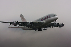 "January 3rd 2015, Heathrow Airport, London. Low cloud and rain provide ideal conditions to observe wake vortexes and ""fluffing"" as moisture condenses over the wings of landing aircraft. With the runway visible only at the last minute, several planes had to perform a ""go-round"", abandoning their first attempts to land. PICTURED: With water streaming off its control surfaces a Qatar Airbus A380 comes in to land on Heathrow's runway 27L ."