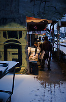 Fish mongers/merchants begin to display there wares as the morning comes into its own.