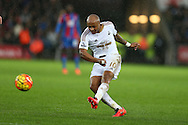 Andre Ayew of Swansea city has a shot at goal. Barclays Premier league match, Swansea city v Crystal Palace at the Liberty Stadium in Swansea, South Wales on Saturday 6th February 2016.<br /> pic by Andrew Orchard, Andrew Orchard sports photography.