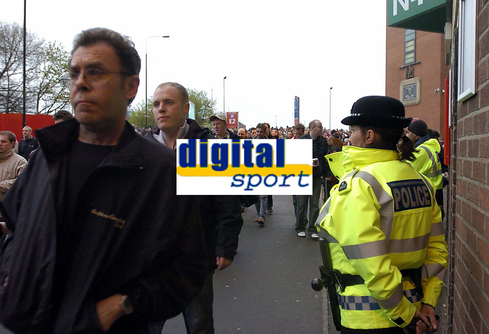 Photo. Jed Wee.<br /> Manchester United v Charlton Atheltic, FA Barclaycard Premiership, 20/04/2004.<br /> Security fears amidst terrorism raids in Manchester sees stepped up security at Old Trafford, as a policewoman scans the crowd for signs of trouble.