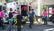 Oct 1, 2015 - Roseburg, Oregon, U.S. - <br /> <br />  A patient is wheeled into the emergency room at Mercy Medical Center in Roseburg, Ore., following a deadly shooting at Umpqua Community College, in Roseburg. A gunman opened fire at an Oregon community college, killing at least a dozen people before dying during a shootout with police, authorities said. Douglas County Sheriff John Hanlin said that officers exchanged gunfire with the shooter, 20, and that ''he is deceased.'' <br /> ©Exclusivepix Media