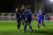 GOAL 1-0, AFC Wimbledon midfielder Jack Rudoni (12) dancing and celebrating during the EFL Sky Bet League 1 match between AFC Wimbledon and Gillingham at Plough Lane, London, United Kingdom on 23 February 2021.