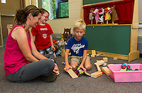 Kiersten Foster, Hayden Cardinal and Ethan Spulick play in the Preschool room at Pleasant Street Elementary on Thursday morning.   (Karen Bobotas/for the Laconia Daily Sun)