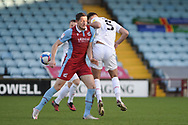 Scunthorpe United Ryan Loft (9) Leyton Orient Dan Happe (5) battles for possession during the EFL Sky Bet League 2 match between Scunthorpe United and Leyton Orient at the Sands Venue Stadium, Scunthorpe, England on 5 December 2020.