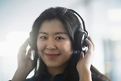Young woman listening to music with headphones, Freiburg im Breisgau, Baden-W¸rttemberg, Germany