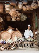 Shopkeeper selling woven baskets in Srinigar, Kashmir, India