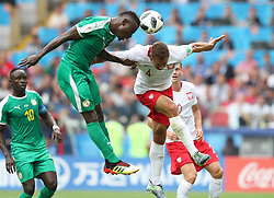 MOSCOW, June 19, 2018  Mame Biram Diouf (L top) of Senegal vies with Thiago Cionek (R top) of Poland during a Group H match between Poland and Senegal at the 2018 FIFA World Cup in Moscow, Russia, June 19, 2018. (Credit Image: © Ye Pingfan/Xinhua via ZUMA Wire)