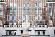 Milan, the Cattelan sculpture in front of the stock exchange building