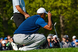 May 16, 2019 - Farmingdale, NY, U.S. - FARMINGDALE, NY - MAY 16: Tiger Woods of the United States lines up his putt on the 12th green during Round One of the PGA Championship Tournament on May 16, 2019, at Bethpage State Park in Farmingdale, NY (Photo by John Jones/Icon Sportswire) (Credit Image: © John Jones/Icon SMI via ZUMA Press)