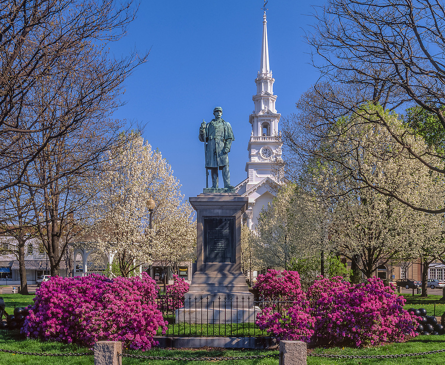 Village park in spring, Congregational Church steeple & statue, flowering trees and bushes, Keene, NH