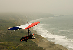 California, San Francisco: A hang glider launching into the fog at Fort Funston..Photo #: 25-casanf31575.Photo © Lee Foster 2008