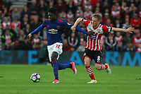 Football - 2016 / 2017 Premier League - Southampton vs. Manchester United<br /> <br /> Axel Tuanzebe of Manchester United holds Southampton's Steven Davis off the ball at St Mary's Stadium Southampton<br /> <br /> COLORSPORT/SHAUN BOGGUST