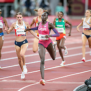 TOKYO, JAPAN August 3:   Athing Mu of the United States hits the finish line to win the gold medal from silver medal winner Keely Hodgkinson of Great Britain and bronze medal winner Raevyn Rogers of the United States in the Women's 800m Final at the Olympic Stadium during the Tokyo 2020 Summer Olympic Games on August 3rd, 2021 in Tokyo, Japan. (Photo by Tim Clayton/Corbis via Getty Images)