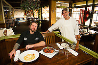 Executive Chef Allen Zick and Head Chef Dave Fraser in Lago's main dining room with two of their signature dishes Gnocchi Carbonara and Seafood Puttenesca.  (Karen Bobotas/for the Laconia Daily Sun)