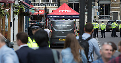 London, June 4th 2017. A private ambulance waits to collect a body during a massive policing operation in the aftermath of the terror attack on London Bridge and Borough Market on the night of June 3rd which left seven people dead and dozens injured