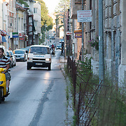 MOSTAR, BOSNIA AND HERZEGOVINA - JUNE 26:  A motor bike passes along  M. Tita road seen on  June 26, 2013 in Mostar, Bosnia and Herzegovina.The Siege of Mostar reached its peak and more cruent time during 1993. Initially, it involved the Croatian Defence Council (HVO) and the 4th Corps of the ARBiH fighting against the Yugoslav People's Army (JNA) later Croats and Muslim Bosnian began to fight amongst each other, it ended with Bosnia and Herzegovina declaring independence from Yugoslavia.  (Photo by Marco Secchi/Getty Images)