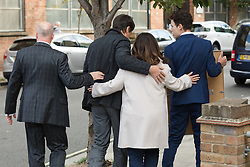 © Licensed to London News Pictures. 28/09/2018. London, UK.  Nadim Ednan-Laperouse, his son Alex and wife Tanya leave West London Coroner's Court with a photograph of Natasha Ednan-Laperouse following the inquest into the death of Natasha Ednan-Laperouse. Natasha Ednan-Laperouse, aged 15, died on a British Airways flight to from London to Niece, when she fell ill after eating a Pret a Manger sandwich believed to contain sesame.  Photo credit: Vickie Flores/LNP