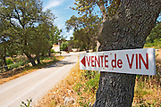 Follow the arrow along the winding road. Vente de Vin, wine for sale. Domaine Ermitage du Pic St Loup, Chateau Ste Agnes. Pic St Loup. Languedoc. France. Europe.