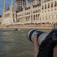 Photographer takes pictures as sportsmen ride a water propelled Flyboard on river Danube in front of the Hungarian Parliament in downtown Budapest, Hungary on Sept. 29, 2017. ATTILA VOLGYI