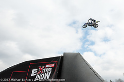 Daredevil motorcycle stunt jumpers perform at the Motor Spring motorcycle show in Moscow, Russia. Saturday April 22, 2017. Photography ©2017 Michael Lichter.