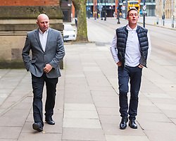 © Licensed to London News Pictures . 23/03/2021. Manchester , UK . Former Manchester United and England footballer RONNIE WALLWORK (left) and DAVID GARNER (right) arrive at Minshull Street Crown Court . Wallwork and Garner face prison after previously pleading guilty to inflicting grievous bodily harm upon a man during an incident at a bar on 22nd December 2019 . Photo credit : Joel Goodman/LNP