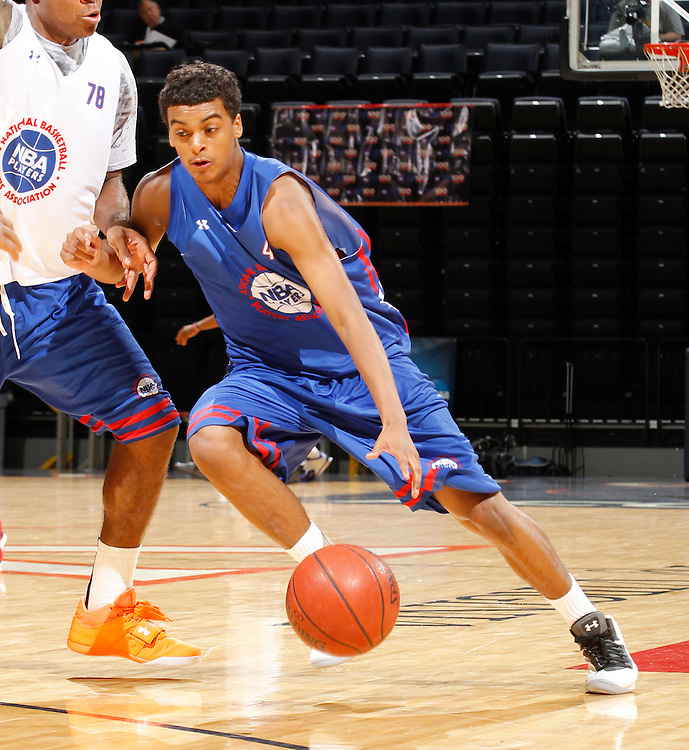 Quentin Snider participates in a basketball camp in Charlottesville, Va. (Photo/Andrew Shurtleff)