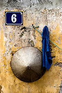 A conical hat, a sweat towel and a French address plat tell a story about the entry way to this working-class Hanoi home. Robert Dodge, a Washington DC photographer and writer, has been working on his Vietnam 40 Years Later project since 2005. The project has taken him throughout Vietnam, including Hanoi, Ho Chi Minh City (Saigon), Nha Trang, Mue Nie, Phan Thiet, the Mekong, Sapa, Ninh Binh and the Perfume Pagoda. His images capture scenes and people from women in conical hats planting rice along the Red River in the north to men and women working in the floating markets on the Mekong River and its tributaries. Robert's project also captures the traditions of ancient Asia in the rural markets, Buddhist Monasteries and the celebrations around Tet, the Lunar New Year. Also to be found are images of the emerging modern Vietnam, such as young people eating and drinking and embracing the fashions and music of the West. His book. Vietnam 40 Years Later, was published March 2014 by Damiani Editore of Italy.