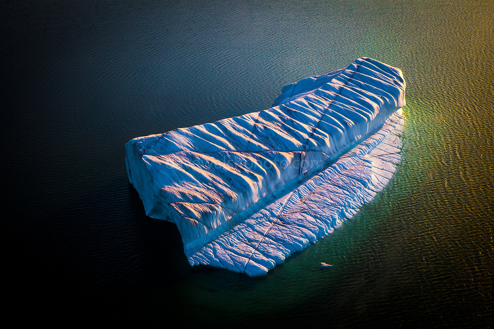 """Aerial photo of crenellated - or corrugated iceberg, drifting near Humboldt Glacier, Greenland. Humbolt glacier is the widest glacier, at 110km, in the northern hemisphere. This mage can be licensed via Millennium Images. Contact me for more details, or email mail@milim.com For prints, contact me, or click """"add to cart"""" to some standard print options."""