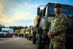 A U.S. Soldier with the 20th Engineer Battalion, 36th Engineer Brigade, waits to load supplies that will be distributed the towns effected Hurricane Harvey in a in a reconnaissance mission to asses the damage and combat the affects of the hurricane at an American Red Cross Distribution Center in Sugar Land, Texas Sep. 3, 2017. The Department of Defense is conducting Defense Support of Civil Authorities operations in response to the effects of Hurricane Harvey. DSCA operations are part of the DOD's response capability to assist civilian responders in saving lives, relieving human suffering and mitigating property damage in response to a catastrophic disaster. (U.S. Army photo by Spc. Hubert D. Delany III)  Please note: Fees charged by the agency are for the agency's services only, and do not, nor are they intended to, convey to the user any ownership of Copyright or License in the material. The agency does not claim any ownership including but not limited to Copyright or License in the attached material. By publishing this material you expressly agree to indemnify and to hold the agency and its directors, shareholders and employees harmless from any loss, claims, damages, demands, expenses (including legal fees), or any causes of action or allegation against the agency arising out of or connected in any way with publication of the material.