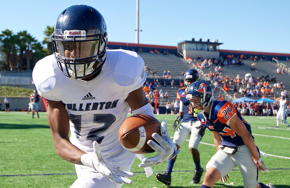 11/5/16 – Football – <br /> <br /> Fullerton Hornet wide receiver Justin Walker (12) drops a pass in the end zone during their game against Orange Coast Pirates at Orange Coast College in Costa Mesa, Calif, Nov. 5, 2016.<br /> <br /> Photo by Seth Laubinger / Sports Shooter Academy