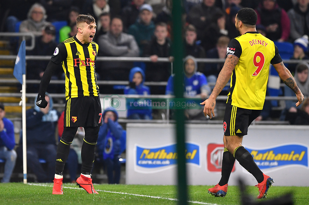 Watford's Gerard Deulofeu (left) celebrates scoring his side's second goal of the game with team-mate Troy Deney during the Premier League match at the Cardiff City Stadium.