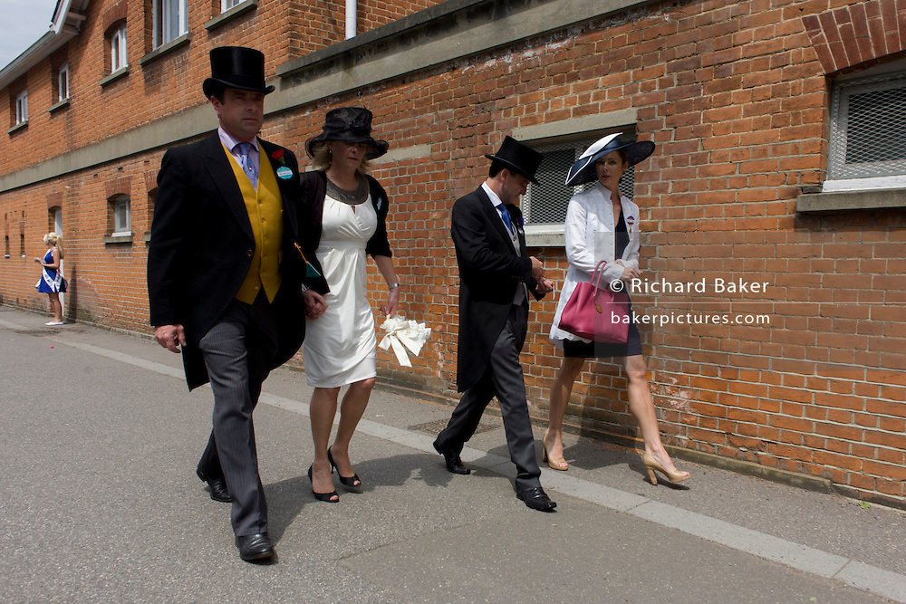 Formally-dressed family arrive at the racecourse during the annual Royal Ascot horseracing festival in Berkshire, England. Royal Ascot is one of Europe's most famous race meetings, and dates back to 1711. Queen Elizabeth and various members of the British Royal Family attend. Held every June, it's one of the main dates on the English sporting calendar and summer social season. Over 300,000 people make the annual visit to Berkshire during Royal Ascot week, making this Europe's best-attended race meeting with over £3m prize money to be won.