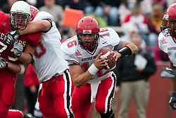 08 Oct 2005  Hilltopper QB Justin Haddix cuts straight up the middle while his guards do plenty of blocking. The Illinois State University Redbirds roped and tied the Western Kentucky University Hilltoppers in regulation but loosened the noose in Overtime as the Hilltoppers take the honors with a 37 - 24 Victory in Gateway Conference action at Hancock Stadium on Illinois State's campus in Normal IL.