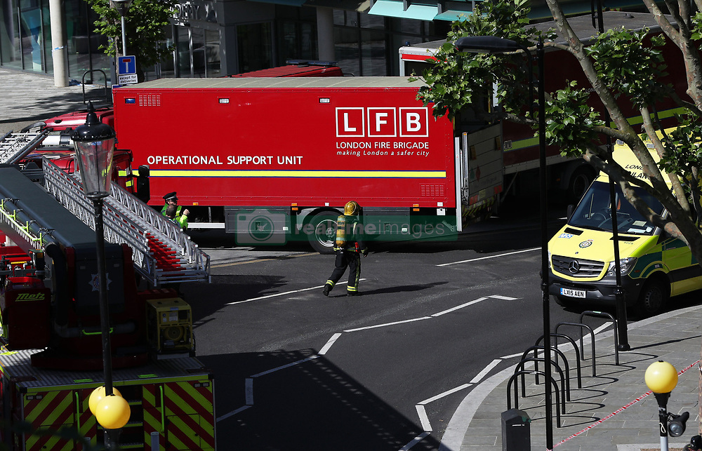 Emergency services close to the scene of a fire that engulfed the 24-storey Grenfell Tower in west London.