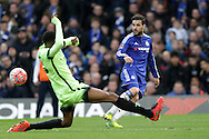 Cesc Fabregas of Chelsea crosses the ball past Tosin Adarabioyo of Manchester City. The Emirates FA Cup, 5th round match, Chelsea v Manchester city at Stamford Bridge in London on Sunday 21st Feb 2016.<br /> pic by John Patrick Fletcher, Andrew Orchard sports photography.