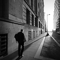 A man heads home after work near Old Hall St.
