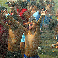 (PMONMOUTH) Sandy Hook 8/13/2002  Joe Dwyer 9 of the Leonardo section of Middletown Twp catches as much water as he can as the Sandy Hook Fire Department hoses down the Monmouth County Council of Boy Scouts Twin Lights district day camp held in a open field on Fort Handcock.   Michael J. Treola Staff Photographer.....MJT