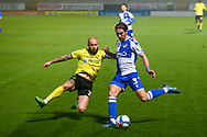 Luke Leahy of Bristol Rovers (3) and John Brayford of Burton Albion (2) battle for the ball during the EFL Sky Bet League 1 match between Burton Albion and Bristol Rovers at the Pirelli Stadium, Burton upon Trent, England on 2 March 2021.