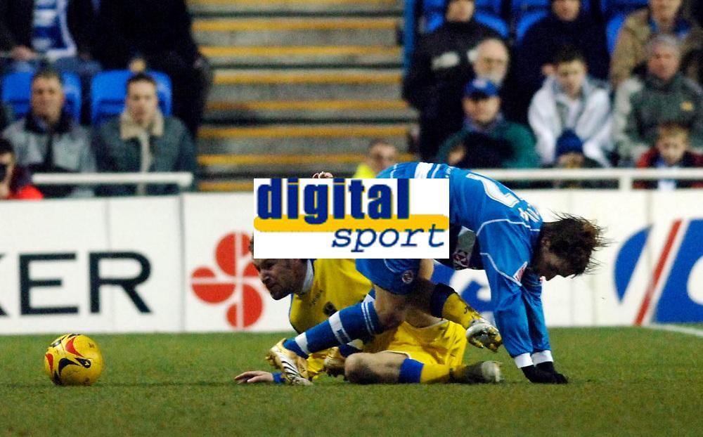 Photo: Daniel Hambury.<br />Reading v Cardiff City. Coca Cola Championship.<br />02/01/2006.<br />Reading's Bobby Convey (R) is tackled by Cardiff's Rhys Weston.
