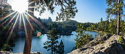 Sylvan Lake sunrise. Custer State Park and wildlife reserve in the Black Hills, in Custer County, South Dakota, USA. South Dakota's largest and first state park was named after Lt. Colonel George Armstrong Custer. This image was stitched from multiple overlapping photos.