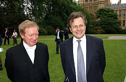 Left to right, Black Rod SIR MICHAEL WILLCOCKS and LORD GOLDSMITH at the annual Macmillan Cancer Support House of Lords vs the House of Commons Tug of War held in Victoria Tower Gardens on 20th June 2006.<br /><br />NON EXCLUSIVE - WORLD RIGHTS