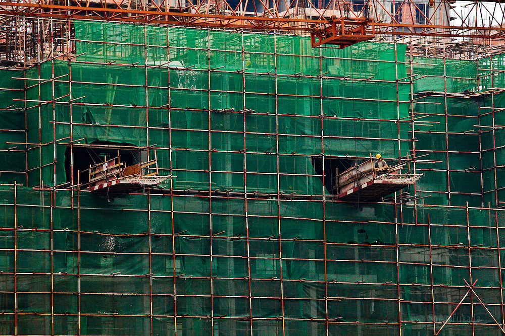 Construction is under way  in Chongqing, China, March 4, 2009.