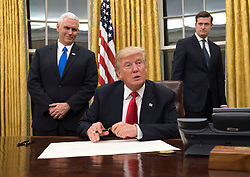President Donald Trump speaks to the media before signing a confirmation for Defense Secretary James Mattis in the Oval Office at the White House in Washington, D.C. on January 20, 2017. Photo by Kevin Dietsch/UPI
