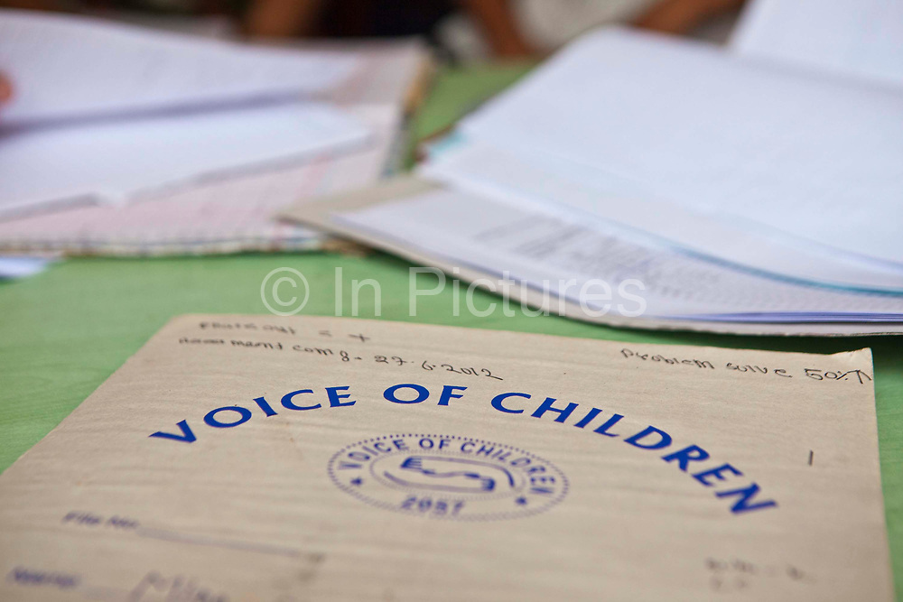 Voice of Children report on a desk in the Voice of Children centre in Kankeshori area of Kathmandu, Nepal.  The not-for-profit organisation supports street children and those who are at risk of sexual abuse through educational and vocational training opportunities, health services and psychosocial counseling.